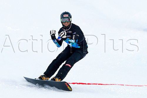 13.12.2013  CAREZZA, ITALY. Mens SNOWBOARD FIS World cup Parallel. Anton Unterkofler (AUT).
