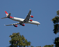 30 SEP 12  A Virgin Airbus A-340 on approach to Chicago Ohares runway 9 Right during Sundays Singles matches  at The 39th Ryder Cup at The Medinah Country Club in Medinah, Illinois.                                          (photo:  kenneth e.dennis / kendennisphoto.com)