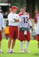 Jul 31, 2009; Flagstaff, AZ, USA; Arizona Cardinals quarterback Kurt Warner (right) talks with head coach Ken Whisenhunt during training camp on the campus of Northern Arizona University. Mandatory Credit: Mark J. Rebilas-