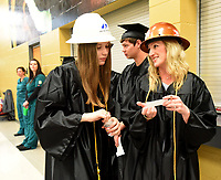 NWA Democrat-Gazette/FLIP PUTTHOFF <br /> CONGRATULATIONS NWACC GRADS<br /> Molly Hedberg (left) and Lisa Lucas wear hard hats on Saturday Saturday May 11 at the 29th annual Northwest Arkansas Community Collegee commencement. Both received degrees in construction technology. Four commencements were held at 10 a.m., noon, 2 p.m. and 4 p.m. at Arend Arts Center on the Bentonville High School campus.