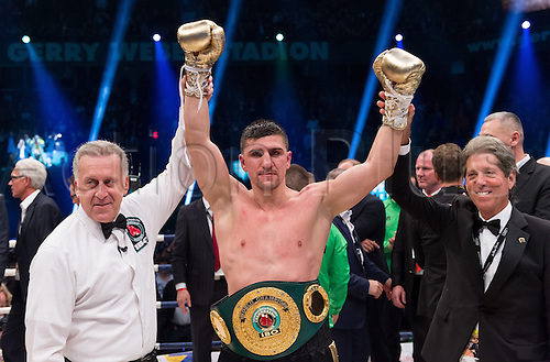 27.02.2016. Halle, Germany.  Marco Huck  (Germany) celebrates after his victory against Ola Afolabi (Great Britain) during the cruiserweight boxing match at the IBO World Championships in Halle, Germany, 27 February 2016. Marco Huck won in the 10th round.