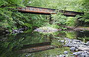 Old bridge along the Rockingham Recreational Rail Trail near the Folsom Conservation Area in Epping, New Hampshire USA