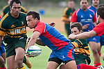 Suliasi Taufalele gets a backward flick pass to Glen Rowe as he dragged to ground by Paul Ivamy.  Counties Manukau Premier Club Rugby game between Ardmore Marist and Pukekohe played at Bruce Pulman Park on Saturday April 17th..Pukekohe won the game 25 - 0 after leading 15 - 0 at halftime.
