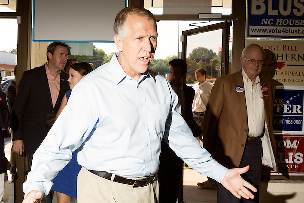 September 20, 2014. Greensboro, North Carolina.<br />  US Senate candidate Thom Tillis greeted rally attendees as he arrived.<br />  Thom Tillis and Mark Walker hosted a rally at the Guilford County Republican Party headquarters for their supporters in the upcoming November election. Tillis, the current Speaker of the House for the NC House of Representatives, is running to take Democrat Kay Hagan's US Senate seat, while Walker, a local pastor, is running for the NC 6th District' s US Congressional seat.