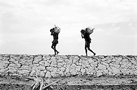 Bangladesh considers the Rohingya to be illegal economic migrants. They are unable to work legally, yet they are an important source of labor. Rohingya working in salt fields near Teknaf earn less than $3 USD per day.