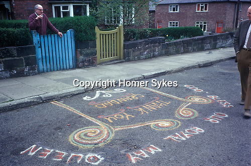 "Royal May Day Knutsford, Cheshire, England. 1973. Sand Painting out side the home of May Queens grandfather. It reads ""God Bless Our Royal May Queen."""