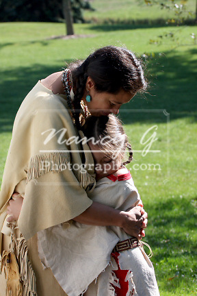 Native American Indian Lakota Sioux mother hugging her daughter