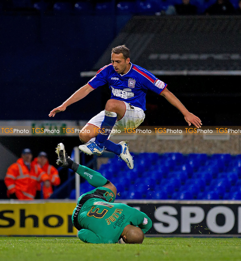 Michael Chopra, Ipswich Town FC hurdles Carl Ikeme, Wolverhampton Wanderers FC - Ipswich Town vs Wolverhampton Wanderers - NPower Championship Football at Portman Road, Ipswich, Suffolk - 19/09/12 - MANDATORY CREDIT: Ray Lawrence/TGSPHOTO - Self billing applies where appropriate - 0845 094 6026 - contact@tgsphoto.co.uk - NO UNPAID USE.