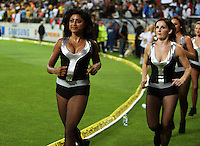 Dancers run out to entertain the corwd between innings during 2nd Twenty20 cricket match match between New Zealand Black Caps and West Indies at Westpac Stadium, Wellington, New Zealand on Friday, 27 February 2009. Photo: Dave Lintott / lintottphoto.co.nz