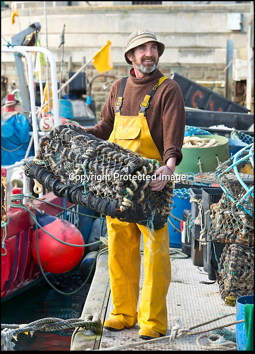 BNPS.co.uk (01202 558833)<br /> Pic: RachelAdams/BNPS<br /> <br /> Kelvin Moore at work in Weymouth Quay<br /> <br /> Lights, camera, plankton!<br /> <br /> A crew of fishermen are enjoying unlikely sideline careers as actors in blockbuster films - thanks to their salty sea dog looks.<br /> <br /> The gang's craggy features, big beards and wild hair have helped them bag roles alongside Hollywood A-listers such as Johnny Depp and Charlize Theron.<br /> <br /> As many as 12 weather-beaten fishermen from Weymouth, Dorset, have found success on the big screen since signing up with a casting agency.<br /> <br /> And thanks to their authentic appearances they are regularly snapped by film producers wanting to make nautical scenes more realistic.