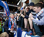 Ally McCoist with the SFL Division 3 trophy and talking to the fans on their megaphone