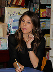 """Cast of Days Of Our Lives - Kate Mansi """"Abigail Devereaux"""" signs book """"Days Of Our Lives 50 Years"""" by Greg Meng - author & co-executive producer on October 27, 2015 at Books & Greetings, Northvale, New Jersey. (Photo by Sue Coflin/Max Photos)"""
