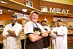 New Season's Market Doug Hope who is the butcher at the store's new location in Fisher's Landing, stands in front of the crew he works with. Back left; Norm Cresmer, Jr., meat cutter, Doug Smith, chicken and sausage, and Mike Castenada, Seafood manager..Photo by Jaime Valdez..... ..