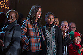 Marian Robinson, left, and First daughters Malia Obama, center, and Sasha Obama, right, look on from the stage during the 91st National Christmas Tree Lighting Ceremony on the Ellipse south of the White House in Washington, DC, USA, 06 December 2013. The lighting of the tree is an annual tradition attended by the US President and the First Family. President Calvin Coolidge lit the first National Christmas tree, a 48-foot Balsam fir, in 1923.<br /> Credit: Jim LoScalzo / Pool via CNP