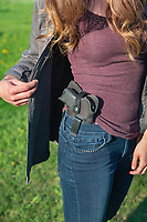 Young woman displaying a Ruger LC9s held in a conceal carry holster.