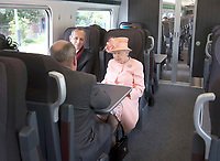 13 June 2017 - Queen Elizabeth II, sits next to Mr Isambard Thomas the Great Great Great Grandson of Isambard Kingdom Brunel, marking the 175th anniversary of the first train journey by a British monarch. The Queen and The Duke of Edinburgh traveling from Slough to London Paddington on a Great Western Railway train, recreating the historic journey made by Queen Victoria on 13th June 1842. Photo Credit: ALPR/AdMedia