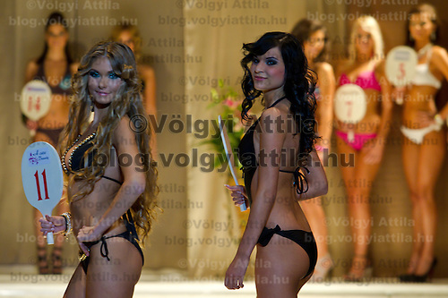 Ivett Venczlik (left) and Aniko Nadas (right) attends the Miss Hungary 2010 beauty contest held in Budapest, Hungary on November 29, 2010. ATTILA VOLGYI