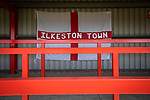 A home team flag in the shed before Ilkeston Town host Walsall Wood in a Midland Football League premier division match at the New Manor Ground, Ilkeston. The home team were formed in 2017 taking the place of Ilkeston FC which had been wound up earlier that year. Watched by a crowd of 1587, their highest of the season, the match was top versus second, however, the visitors won 4-0 and replaced their hosts at the top of the division on goal difference with two matches to play