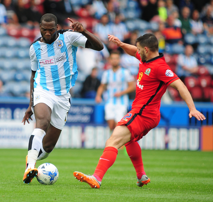 Huddersfield Town's Ishmael Miller vies for possession with Blackburn Rovers' Craig Conway <br /> <br /> Photographer Andrew Vaughan/CameraSport<br /> <br /> Football - The Football League Sky Bet Championship - Huddersfield Town v Blackburn Rovers - Saturday 15th August 2015 - The John Smith's Stadium - Huddersfield<br /> <br /> &copy; CameraSport - 43 Linden Ave. Countesthorpe. Leicester. England. LE8 5PG - Tel: +44 (0) 116 277 4147 - admin@camerasport.com - www.camerasport.com