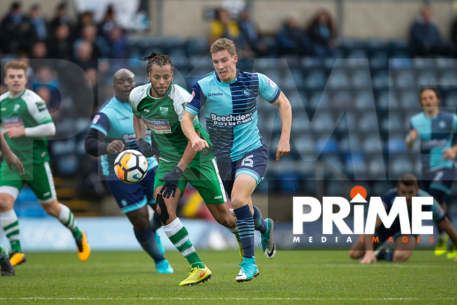 Dayle Southwell of Wycombe Wanderers under pressure from Yannis Ambroisine of Leatherhead during the FA Cup 2nd round match between Wycombe Wanderers and Leatherhead at Adams Park, High Wycombe, England on 3 December 2017. Photo by Andy Rowland.