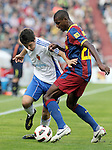 Real Zaragoza's Ander Herrera (l) FC Barcelona's Eric Abidal during La Liga match.October 23,2010. (ALTERPHOTOS/Acero)