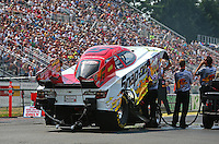 Aug. 2, 2014; Kent, WA, USA; NHRA funny car driver Cruz Pedregon with crew during qualifying for the Northwest Nationals at Pacific Raceways. Mandatory Credit: Mark J. Rebilas-USA TODAY Sports