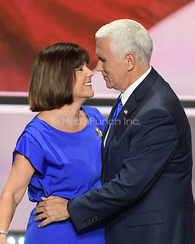 Governor Mike Pence (Republican of Indiana), the GOP nominee for Vice President of the United States and his wife Karen after he delivered his acceptance speech at the 2016 Republican National Convention held at the Quicken Loans Arena in Cleveland, Ohio on Wednesday, July 20, 2016.<br /> Credit: Ron Sachs / CNP/MediaPunch<br /> (RESTRICTION: NO New York or New Jersey Newspapers or newspapers within a 75 mile radius of New York City)