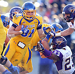 BROOKINGS, SD - OCTOBER 26:  Zach Zenner #31 from South Dakota State University breaks through the defense of Zach Cutkomp #23 from Northern Iowa in the third quarter of their game Saturday afternoon at Coughlin Alumni Stadium in Brookings. (Photo by Dave Eggen/Inertia)