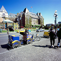 Victoria, BC, Vancouver Island, British Columbia, Canada - Pedicabs waiting for Tourists outside Fairmont Empress Hotel
