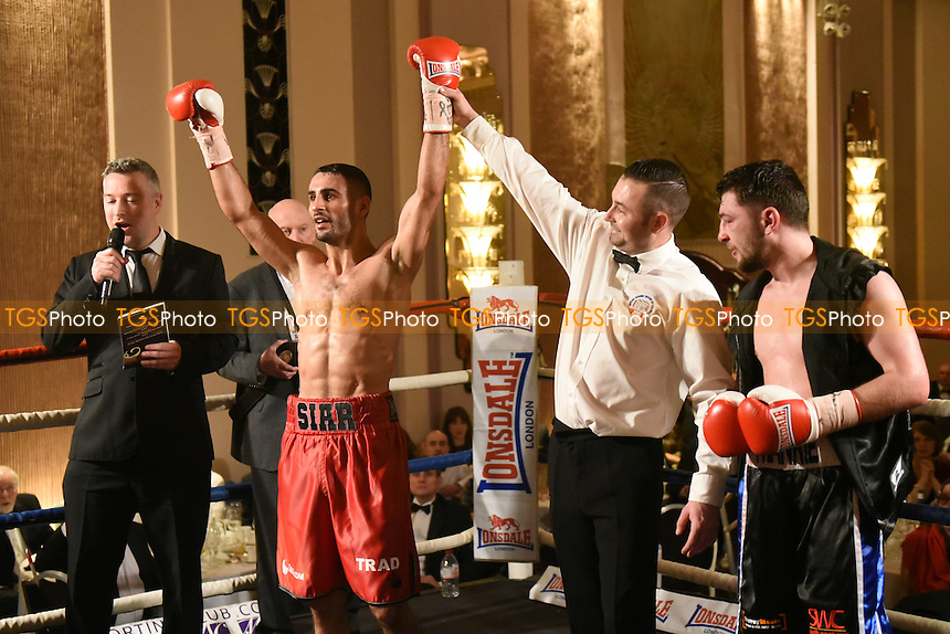 Siar Ozgul (red shorts) defeats Danny Parsons during a Boxing Show at the Sheraton Grand London Park Lane Hotel on 26th January 2017