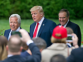 From left to right: New England Patriots owner Robert Kraft, United States President Donald J. Trump, and Patriots head coach Bill Belichick arrive for the ceremony where the President welcomed the Super Bowl Champions to the South Lawn of White House in Washington, DC on Wednesday, April 19, 2917.<br /> Credit: Ron Sachs / CNP<br /> (RESTRICTION: NO New York or New Jersey Newspapers or newspapers within a 75 mile radius of New York City)