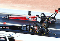 Mar 30, 2014; Las Vegas, NV, USA; NHRA top fuel driver J.R. Todd (near lane) races alongside Steve Torrence during the Summitracing.com Nationals at The Strip at Las Vegas Motor Speedway. Mandatory Credit: Mark J. Rebilas-