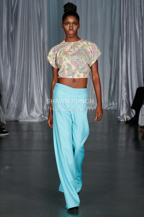 Model walks runway in an outfit from the Bradley Douglas Jordan Spring Summer 2014 collection by Bradley Jordan, during Fashion Week Brooklyn Spring Summer 2014, in Brooklyn, New York on October 4, 2013.