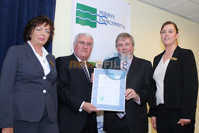 Murphy Environmental is Presented with there ISO 14001 there second such award in a year by Minister Dick Roche. Minister Roche (2L) presented the awards a a funchion in the Boyne Valley Hotel in Drogheda to Seamus Murphy Managing Director of Murphy Environmental (2R) pictured with Patricia Rooney Manager and Emma MurphyFacility Manager in Gormanstown. Murphy Environmental  received this award the third awarded by the EPA for a waste managment Landfill, there Hold one also for there Hollywood facility..Photo NEWSFILE/FRAN CAFFREY..(Photo credit should read FRAN CAFFREY/NEWSFILE)..NO REPO FEE..This Picture has been sent you under the condtions enclosed by:.Newsfile Ltd..the Studio,.Millmount Abbey,.Drogheda,.Co Meath..Ireland..Tel: +353(0)41-9871240.Fax: +353(0)41-9871260.GSM: +353(0)86-2500958.email: pictures@newsfile.ie.www.newsfile.ie.FTP: 193.120.102.198..This picture is from Fran Caffrey@newsfile.ie