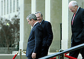 United States President George W. Bush, accompanied by United States Vice President Dick Cheney and United States Secretary of Defense Donald Rumsfeld departs the Pentagon in Washington, D.C. on January 13, 2005 after their meetings.<br /> Credit: Jay L. Clendenin / Pool via CNP