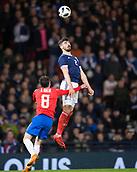 23rd March 2018, Hampden Park, Glasgow, Scotland; International Football Friendly, Scotland versus Costa Rica; Callum Paterson of Scotland rises above Bryan Oviedo of Costa Rica