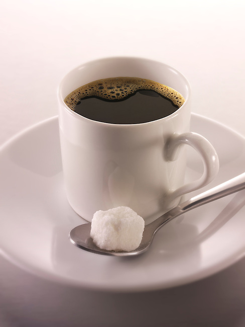 Fresh black espresso coffee in a white coffee cup