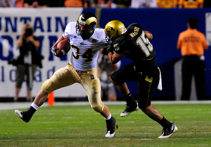 31 Aug 2008: Colorado State running back Kyle Bell (34) is cought by Colorado free safety Ryan Walters (15). The Colorado Buffaloes defeated the Colorado State Rams 38-17 at Invesco Field at Mile High in Denver, Colorado. FOR EDITORIAL USE ONLY