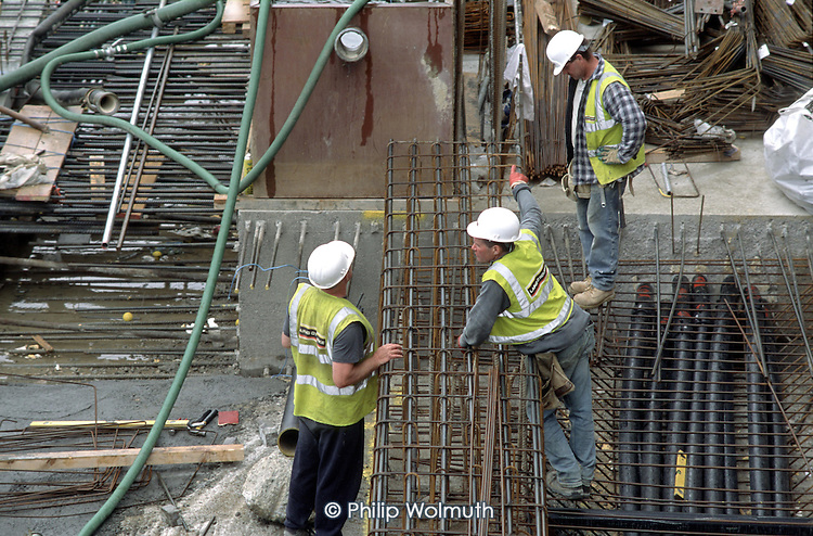 Construction workers prepare reinforced concrete sections on a buildingsite at Canary Wharf on the Isle of Dogs, London.