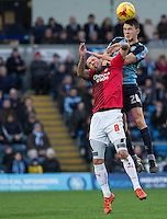 Luke O'Nien of Wycombe Wanderers beats Jimmy Smith of Crawley Town to the ball during the Sky Bet League 2 match between Wycombe Wanderers and Crawley Town at Adams Park, High Wycombe, England on 28 December 2015. Photo by Andy Rowland / PRiME Media Images