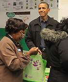 United States President Barack Obama smiles after filling bags with produce at the Capital Area Food Bank in North East Washington DC on Wednesday, November 23, 2011.  ISP pool photo by Dennis Brack/Black Star.Credit: Dennis Brack / Pool via CNP