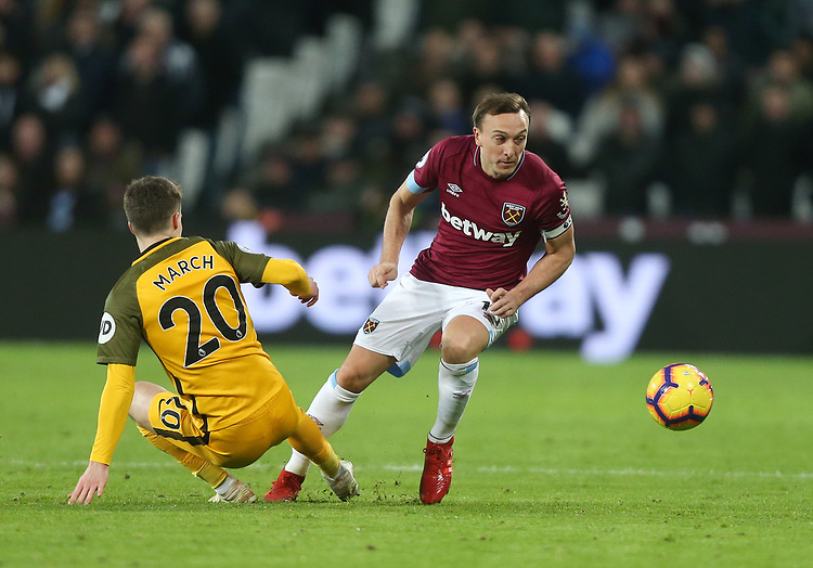 West Ham United's Mark Noble and Brighton & Hove Albion's Solly March<br /> <br /> Photographer Rob Newell/CameraSport<br /> <br /> The Premier League - West Ham United v Brighton and Hove Albion - Wednesday 2nd January 2019 - London Stadium - London<br /> <br /> World Copyright © 2019 CameraSport. All rights reserved. 43 Linden Ave. Countesthorpe. Leicester. England. LE8 5PG - Tel: +44 (0) 116 277 4147 - admin@camerasport.com - www.camerasport.com