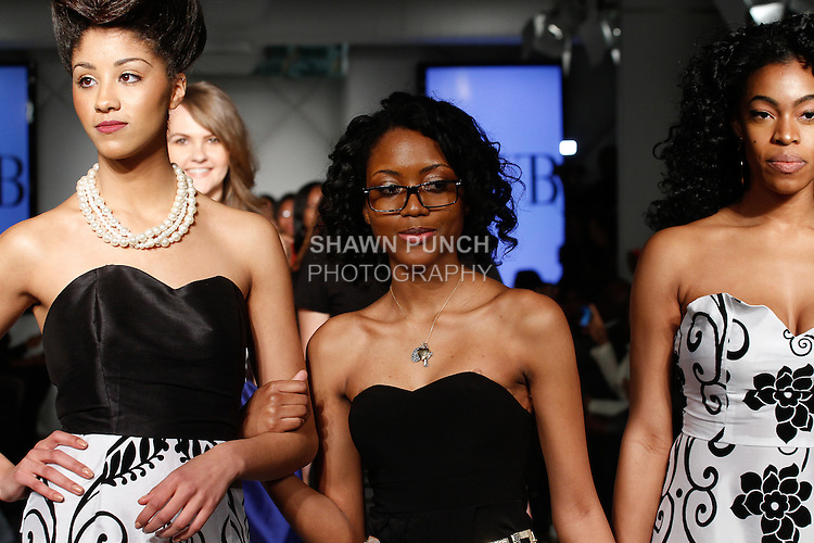 William H. Maxwell High School fashion student walks runway with models, at the close of their Fall Winter 2014 collection fashion show, during Fashion Week Brooklyn Fall Winter 2014, Day 1 at Industry City, on March 13, 2014.