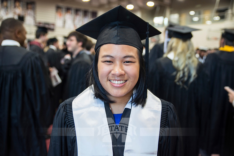 Sara Hoang, a chemical engineering student, smiles while preparing for the 2017 MSU Spring Graduation at Humphrey Coliseum.<br />