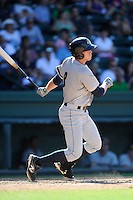 Left fielder Chris Breen (8) of the Charleston RiverDogs bats in a game against the Greenville Drive on Sunday, June 28, 2015, at Fluor Field at the West End in Greenville, South Carolina. Charleston won, 12-9. (Tom Priddy/Four Seam Images)