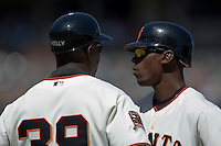 12 April 2008: First base coach Roberto Kelly talks to #14 Fred Lewis of the Giants during the St. Louis Cardinals 8-7 victory over the San Francisco Giants at the AT&T Park in San Francisco, CA.