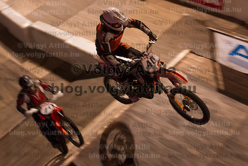 Robert Berenyi from Hungary competes during the Indoor Super Moto-Cross race in Budapest, Hungary on February 4, 2012. ATTILA VOLGYI
