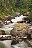 Glacial Creek flows in summer in Rocky Mountain National Park in Colorado