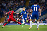 Chelsea's Cesc Fabregas vies for possession with Huddersfield Town's Rajiv van La Parra <br /> <br /> Photographer Craig Mercer/CameraSport<br /> <br /> The Premier League - Chelsea v Huddersfield Town - Wednesday 9th May 2018 - Stamford Bridge - London<br /> <br /> World Copyright &copy; 2018 CameraSport. All rights reserved. 43 Linden Ave. Countesthorpe. Leicester. England. LE8 5PG - Tel: +44 (0) 116 277 4147 - admin@camerasport.com - www.camerasport.com
