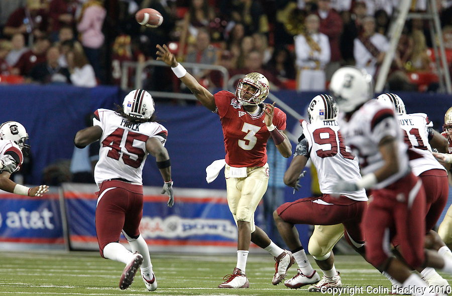 ATLANTA, AG 12/31/10-FSU-SC FB10 CH-Florida State's EJ Manuel throws against South Carolina during second half action Friday at the Chick-fil-A Bowl in Atlanta. The Seminoles beat the Gamecocks 26-17..COLIN HACKLEY PHOTO